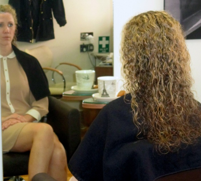 Here we are prepping her curls ready for her hair to be straightened